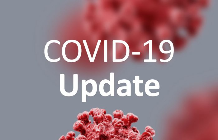 COVID19 Updaye Text over Virus background