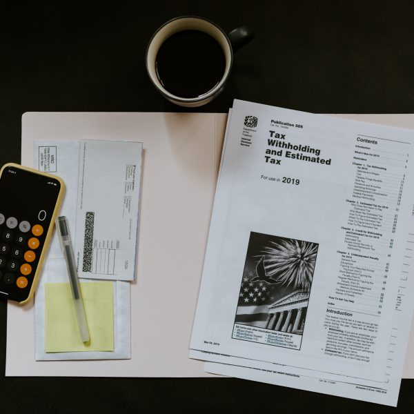 tax withhold statement and iphone on table with coffee