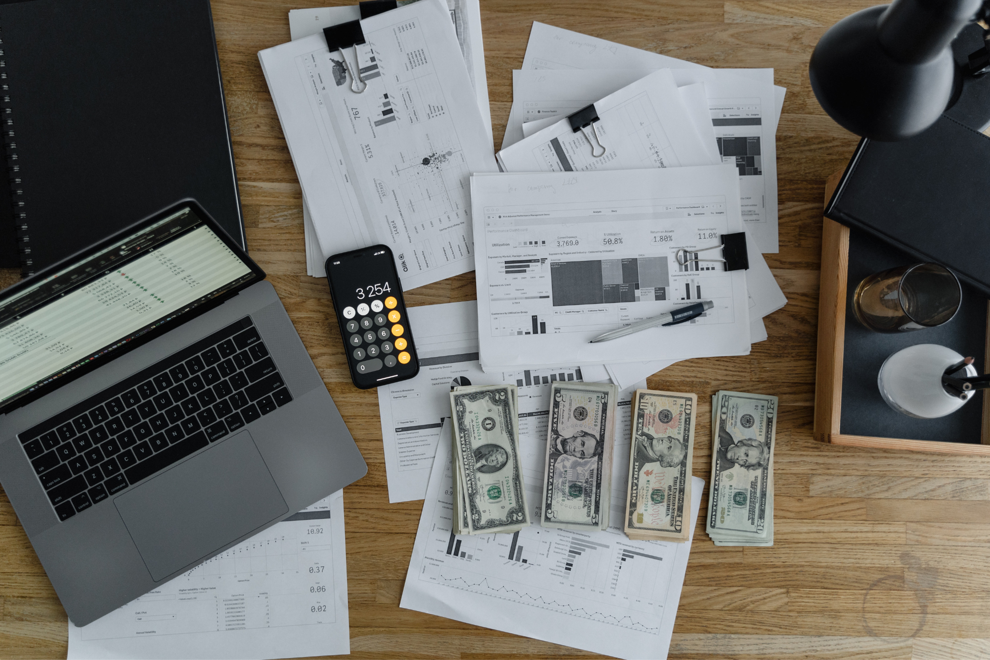 accounting desk with money, receipts calculator and computer